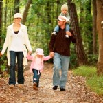 Family taking a walk through the woods.